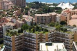 Monaco building roofs with green gardens on