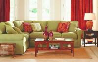 zielony narożnik kolorowy salon pełen życia aranżacja