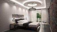 Ciekawa aranżacja sypialni. Sufit podwieszany, okrąg wraz z doświetleniem, żyrandolami
