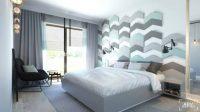 Obicia welurowe na ścianie za łóżkiem w sypialni